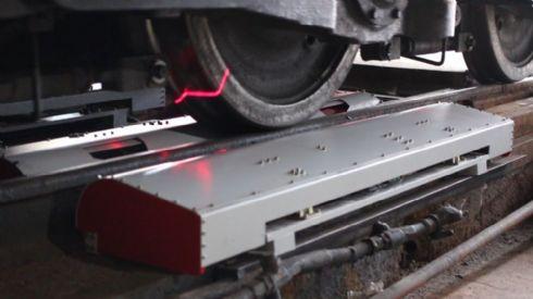 """Sistema de medição estacionário de perfil e diâmetro de rodas ferroviárias em passagem - perfilômetro """"way side"""""""